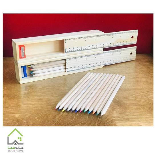 تصویر مداد رنگی و جا مدادی چوبی