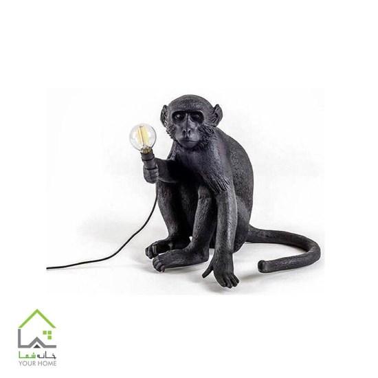 مجسمه میمون بازیگوش نشسته